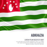Silky flag of Abkhazia waving on an isolated white background with the white text area for your advert message. Stock Image