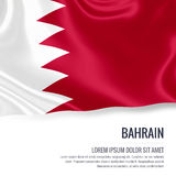 Silky flag of Bahrain waving on an isolated white background with the white text area for your advert message. Stock Photos