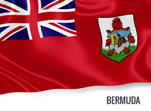 Silky flag of Bermuda waving on an isolated white background. Stock Photography