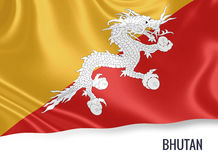 Silky flag of Bhutan waving on an isolated white background. Stock Photography