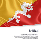 Silky flag of Bhutan waving on an isolated white background with the white text area for your advert message. Stock Photography