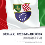 Silky flag of Bosnia and Herzegovina Federation waving on an isolated white background with the white text area. Royalty Free Stock Photo