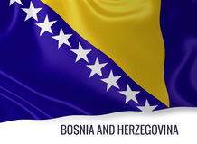 Silky flag of Bosnia and Herzegovina waving on an isolated white background. Stock Image