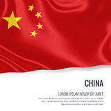 Silky flag of China waving on an isolated white background with the white text area for your advert message. Royalty Free Stock Photos