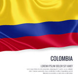 Silky flag of Colombia waving on an isolated white background with the white text area for your advert message. Royalty Free Stock Image