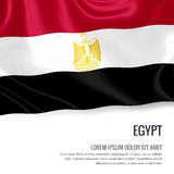 Silky flag of Egypt waving on an isolated white background with the white text area for your advert message. Royalty Free Stock Images