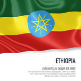 Silky flag of Ethiopia waving on an isolated white background with the white text area for your advert message. Royalty Free Stock Photography