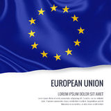 Silky flag of European Union waving on an isolated white background with the white text area for your advert message. Stock Photo