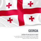 Silky flag of Georgia waving on an isolated white background with the white text area for your advert message. Royalty Free Stock Images