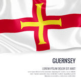 Silky flag of Guernsey waving on an isolated white background with the white text area for your advert message. Royalty Free Stock Image