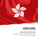 Silky flag of Hong Kong waving on an isolated white background with the white text area for your advert message. Stock Photography