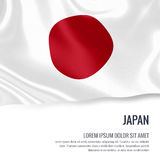 Silky flag of Japan waving on an isolated white background with the white text area for your advert message. Royalty Free Stock Photo