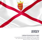 Silky flag of Jersey waving on an isolated white background with the white text area for your advert message. Royalty Free Stock Images
