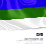 Silky flag of Komi waving on an isolated white background with the white text area for your advert message. Royalty Free Stock Photography