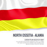 Silky flag of North Ossetia-Alania waving on an isolated white background with the white text area for your advert message. Royalty Free Stock Photo