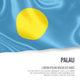 Silky flag of Palau waving on an isolated white background with the white text area for your advert message. Royalty Free Stock Photography