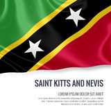 Silky flag of Saint Kitts and Nevis waving on an isolated white background with the white text area for your advert message. Stock Image