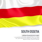 Silky flag of South Ossetia waving on an  white background with the white text area for your advert message. Royalty Free Stock Photo