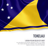 Silky flag of Tokelau waving on an isolated white background with the white text area for your advert message. Royalty Free Stock Photos