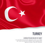 Silky flag of Turkey waving on an isolated white background with the white text area for your advert message. Royalty Free Stock Image