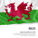 Silky flag of Wales waving on an isolated white background with the white text area for your advert message. Royalty Free Stock Images