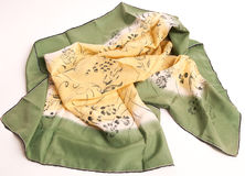 Silky head scarf in shades of green and yellow Royalty Free Stock Photos