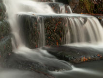 Silky water cascading down some rocks Stock Image