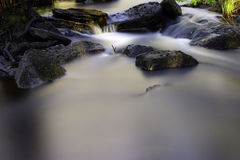 Silky water and stone Royalty Free Stock Photography