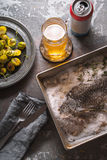 Sill life with fish , Brussels sprouts and beer on the stone background Royalty Free Stock Photo