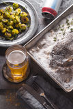 Sill life with fish , Brussels sprouts and beer vertical Stock Photography