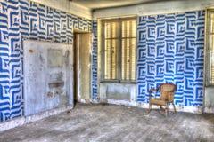 Silla abandonada en un hotel Foto de archivo