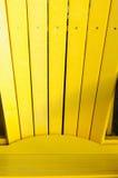 Silla amarilla del adirondack Imagenes de archivo