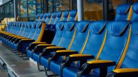 Silla azul en estadio del deporte Imagen de archivo libre de regalías