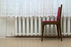 Silla cerca de la ventana Fotos de archivo libres de regalías