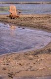 Silla de césped en una playa Fotos de archivo