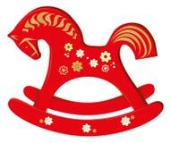 silla de madera del caballo de oscilación Foto de archivo libre de regalías