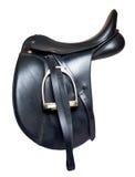 Silla de montar de cuero negra de la doma aislada en el fondo blanco Fotografía de archivo libre de regalías