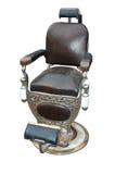 Silla de peluquero antigua Imagen de archivo libre de regalías