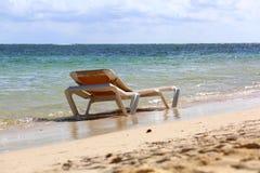 Silla de playa en la playa Imagen de archivo libre de regalías