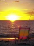 Silla de playa en la puesta del sol imágenes de archivo libres de regalías