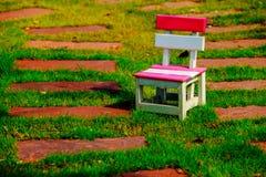 Silla en jardín Foto de archivo
