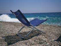 Silla en la playa Foto de archivo