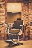 Silla en peluquería de caballeros Imagen de archivo libre de regalías
