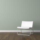 Silla moderna blanca en la pared verde Imagenes de archivo