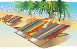 Silla o cama colorida en la playa Fotografía de archivo libre de regalías