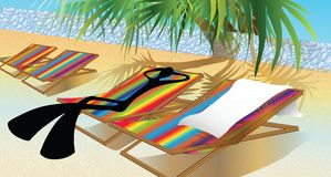 Silla o cama colorida en la playa Imagen de archivo