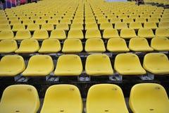 Silla plástica amarilla Foto de archivo libre de regalías