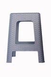 Silla plástica gris aislada en el bsckground blanco Fotos de archivo libres de regalías