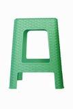 Silla plástica verde aislada en el bsckground blanco Imágenes de archivo libres de regalías