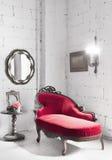 Silla roja en el cuarto Imagen de archivo libre de regalías